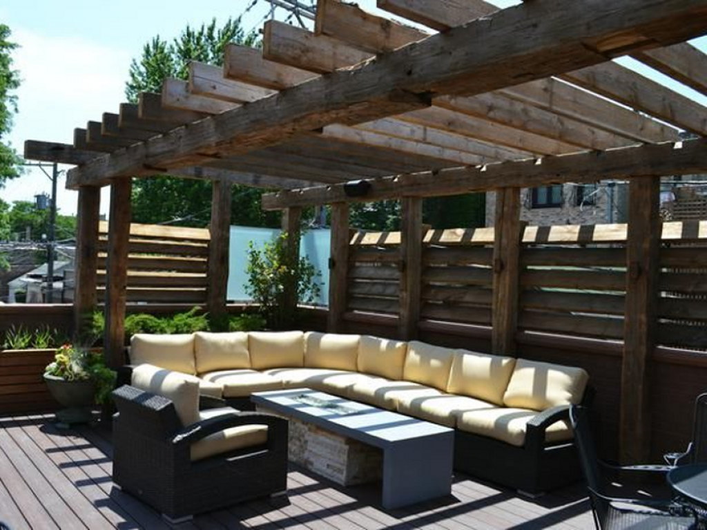 Patio-pergola living area made of rustic timbers