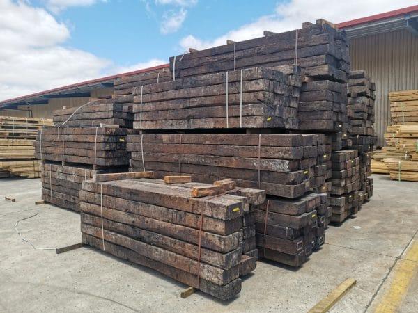 Railway sleepers bundled and stacked