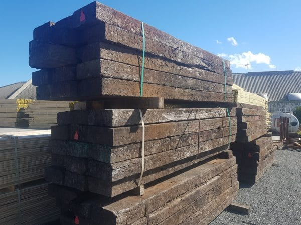 three bundles of large railway sleepers