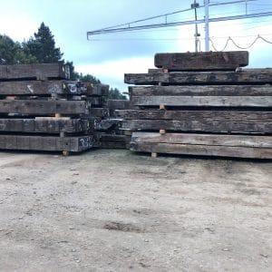 stockpile of stacked bridge beams