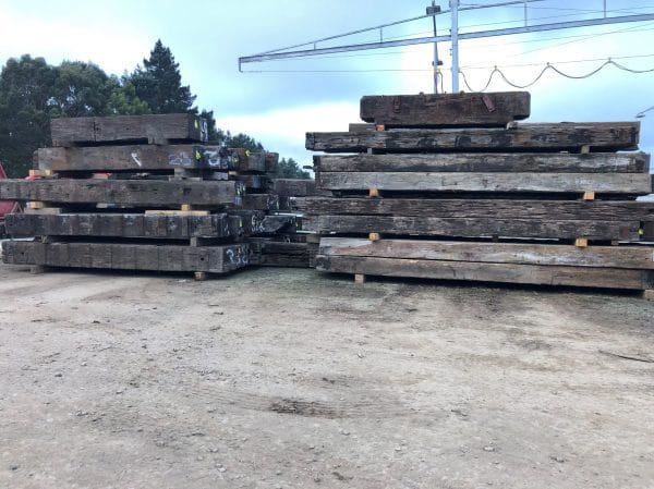stockpile of stacked bridge beams
