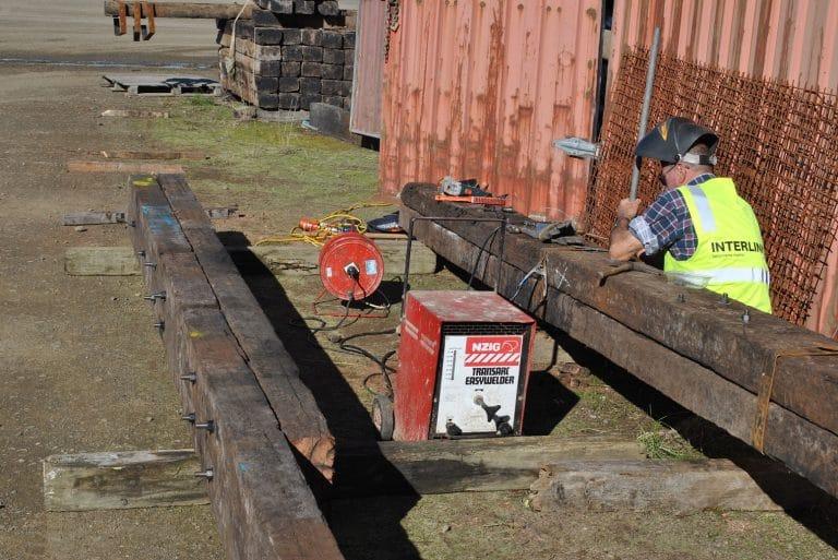 man welding european beams