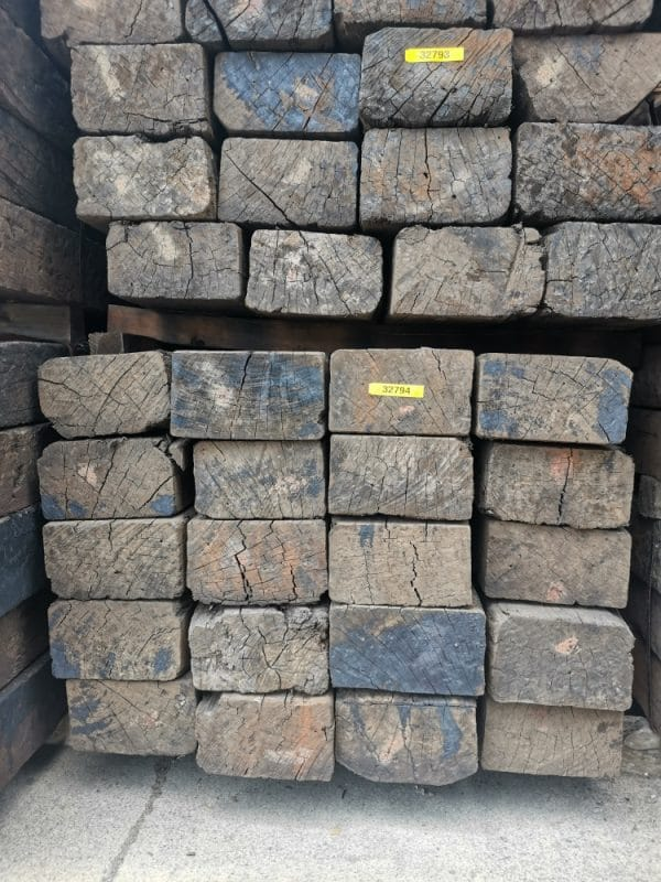 stacked railway sleepers with ends only visable