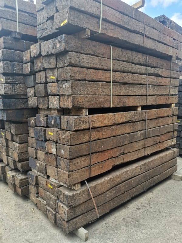 Angle view of Ironwood railway sleepers stacked in bundles