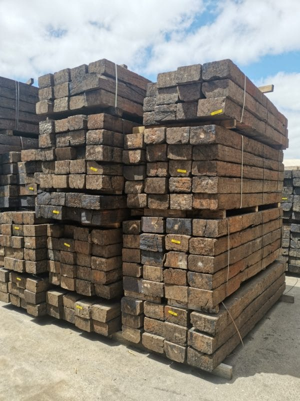 Ends and sides of bundles of Ironwood railway sleepers stacked