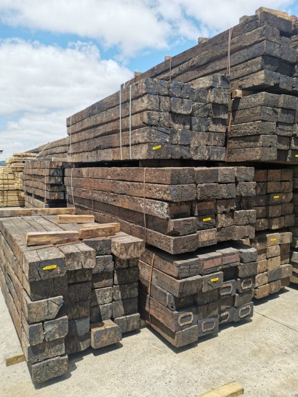 Front view of stacked bundles of railway sleepers