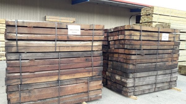Front shot of bundled new railway sleepers stacked