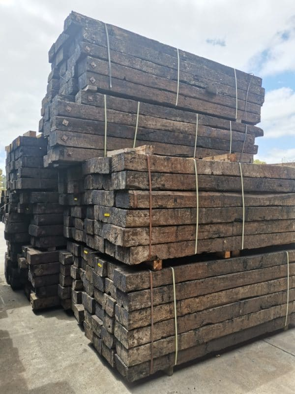 side view of stacked bundles of railway sleepers