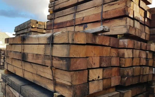 blose up of New railway sleepers stacked in bundles