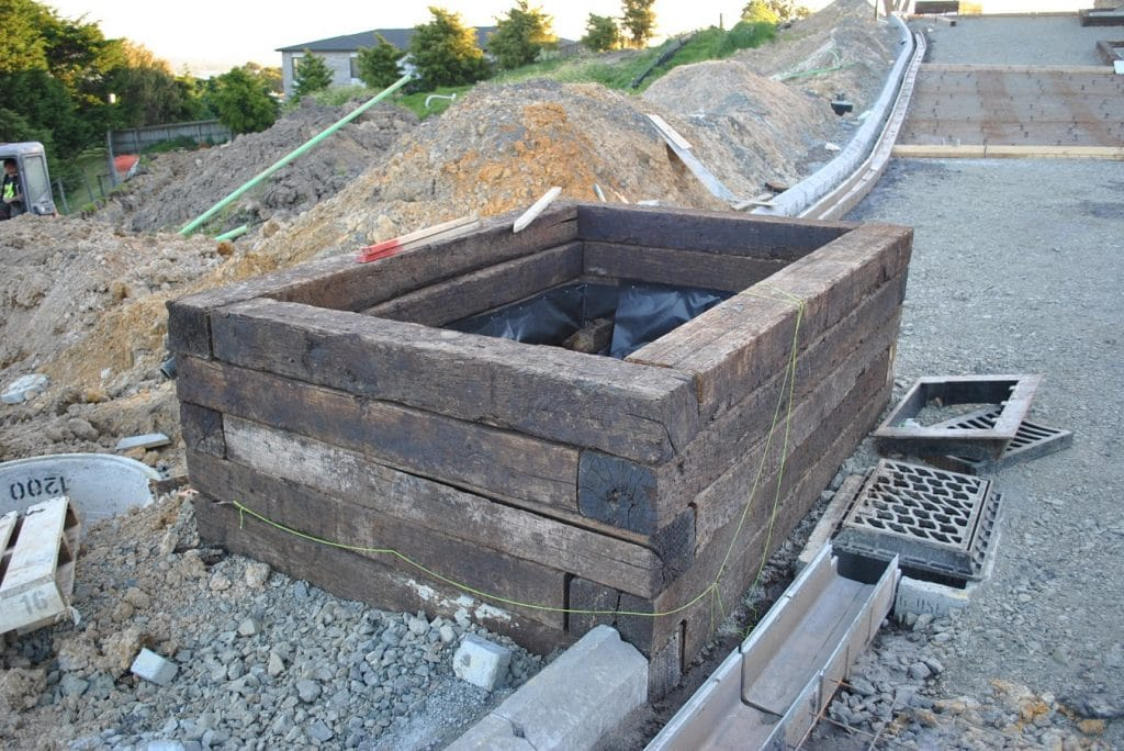 Planter box with railway sleepers on construction site