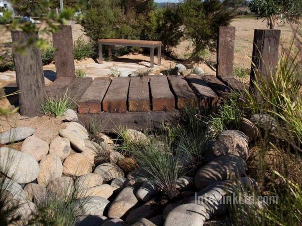 side view of rock garden bridge made from railway sleepers