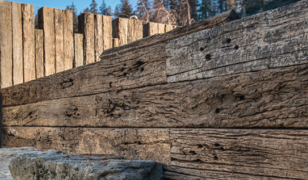 retaining wall with rustic timber close up