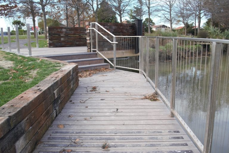 low retaining with pathway and hand rail