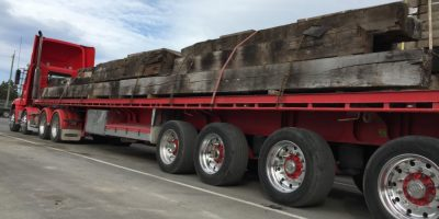 long truck and trailer with beams
